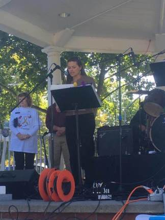 Lisa Keim presents Gov. Paul LePage's proclamation to make the state of Maine go gold for the month of September at the Go Gold festival on Saturday at the Bethel Common.